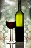 Red wine against holiday lights Royalty Free Stock Image