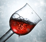 Red wine against and holiday lights Royalty Free Stock Images