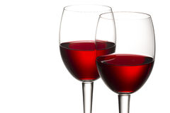 Red wine against white background. Close-up shot of red wine in wineglass against white background Stock Photography