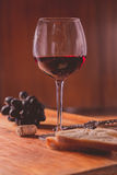 Red wine against wooden background Stock Photo