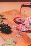 Red wine against wooden background Stock Photography