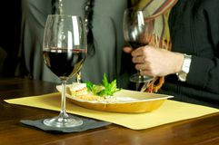 Red wine and appetizer. Drinking and heating in Enoteca Stock Image