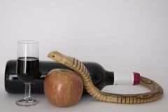 The temptation. Red wine as tentative as the apple offered by the serpent Stock Photo