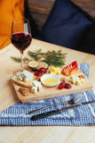 Red Wine And Assorted Cheese Plate with fruit Royalty Free Stock Image
