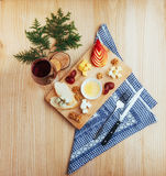 Red Wine And Assorted Cheese Plate with fruit Stock Images