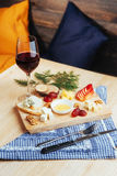 Red Wine And Assorted Cheese Plate with fruit. Stock Photography