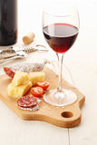 Red wine and assortment of snacks Royalty Free Stock Photo