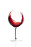 Red Wine in a Balloon Glass. Splash Stock Photos
