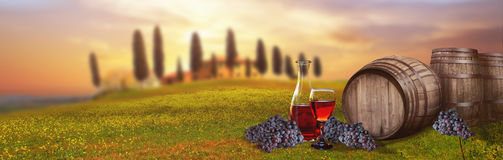 Red wine barrel against Tuscan landscape Italy. Grapes Royalty Free Stock Photos