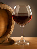 Red wine barrel and glass. Red wine barell and glass on a wooden table stock images