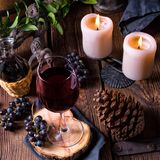 Red wine from a barrel with grapes and a glass of wine Royalty Free Stock Photo