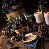 Red wine from a barrel with grapes and a glass of wine Stock Image
