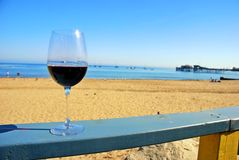 Red Wine at the Beach Royalty Free Stock Photos