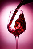 Red wine being poured royalty free stock photo
