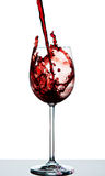Red wine being poured into a crystal wine glass Royalty Free Stock Images
