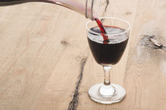 Red wine being poured from decanter Royalty Free Stock Images