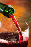 Red wine being poured into glass. Red wine being poured into wine glass Royalty Free Stock Photo