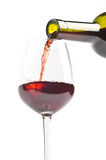 Red wine. Being poured into wine glass Royalty Free Stock Images