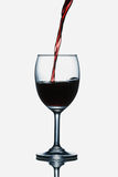 Red wine. Being poured into a glass Stock Photo