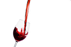 Red wine being poured into a wine glass. In a glass of red wine peppy is empty. red wine in wine glass Stock Photos