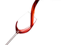 Red wine being poured into a wine glass. Add a glass of red wine is lively empties. red wine in wine glass Stock Photos