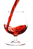 Red wine being served into a glass cup Royalty Free Stock Images