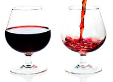Red wine being served in transparent glasses Stock Photo