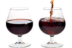 Red wine being served in transparent glasses Royalty Free Stock Photo