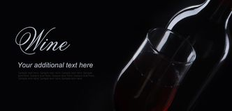 Red wine on black background in decorative lighting Stock Photography