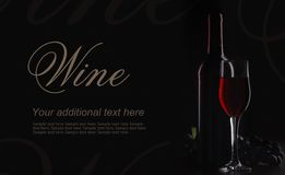 Red wine on black background in decorative lighting stock photo