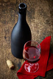 Red wine and black bottle Royalty Free Stock Photo
