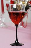 Red wine in a black stemmed glass close up Royalty Free Stock Images