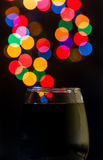 Red wine bokeh. A glass of red wine and some sparkling lights in the back stock photo