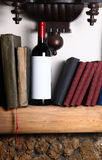 Red wine and books Stock Photos