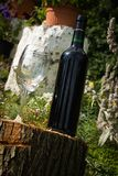 Red Wine. Bootled on log Stock Photo
