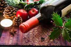 Red wine bottle with candle Royalty Free Stock Image