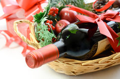 Red wine bottle in a basket royalty free stock photos
