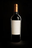 Red Wine Bottle on Black Background Royalty Free Stock Photography