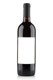 Red wine bottle with blank label on white Stock Photo