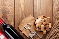 Red wine bottle, bowl with corks and corkscrew. View from above Royalty Free Stock Photography