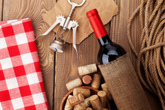 Red wine bottle, bowl with corks and corkscrew. View from above Stock Image