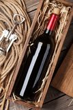 Red wine bottle in box Stock Image