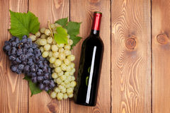 Red wine bottle and bunch of grapes Stock Photo