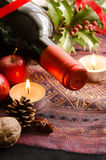 Red wine bottle with candle Stock Image