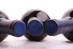 Red wine bottle with a cap. Red wine bottle with a blue cap Stock Image
