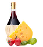 Red wine bottle, cheese and tomato still life Royalty Free Stock Images