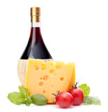 Red wine bottle, cheese and tomato still life Royalty Free Stock Photo
