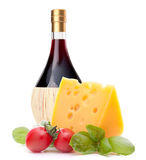 Red wine bottle, cheese and tomato still life Stock Photo