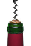 Red wine bottle cork and corkscrew close up Royalty Free Stock Photos