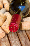 Red  wine bottle and corks Royalty Free Stock Photography